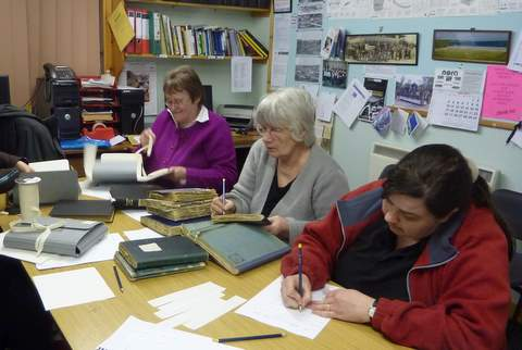 Members of Tolsta Historical Society eagerly cataloguing!
