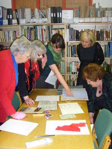 Delegates learning to identify damage that can occur to archives