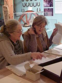 Mary and Chrissie work on the Macdonald of Crombhag family paper