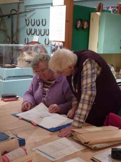 Margaret and Mary sort through the North Uist Community Council records