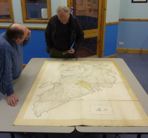 Exploring the Leverhume map showing the proposed train line around Lewis