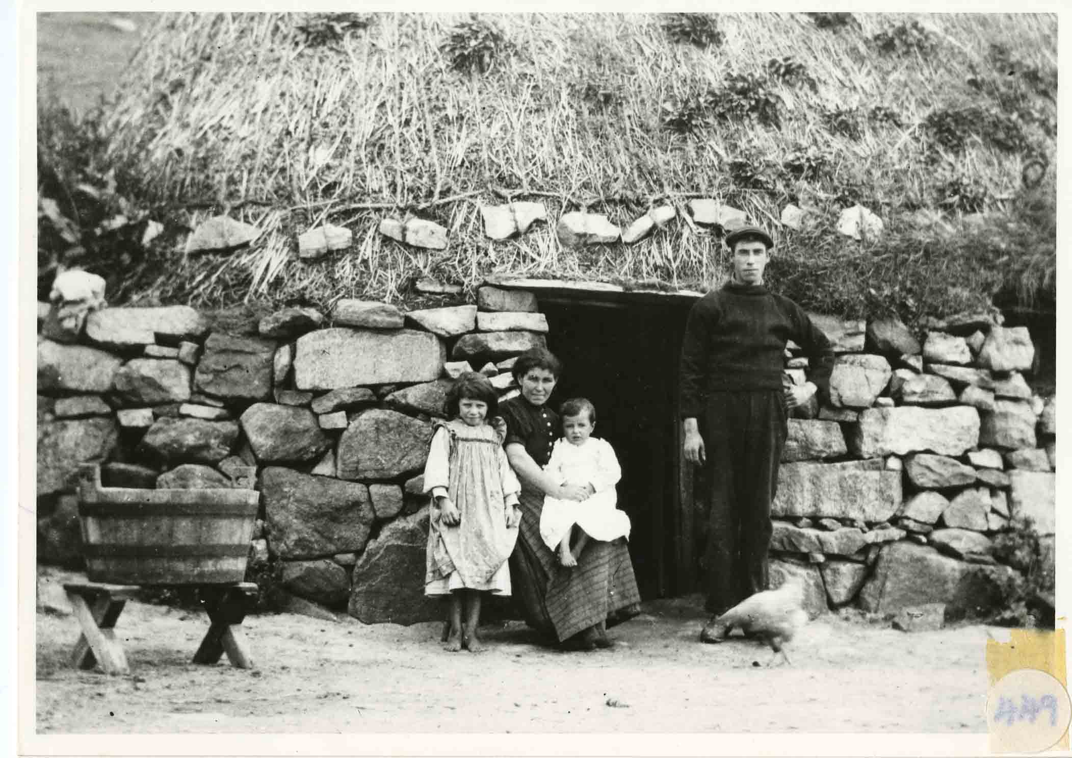 A family in the doorway of their house on Eriskay