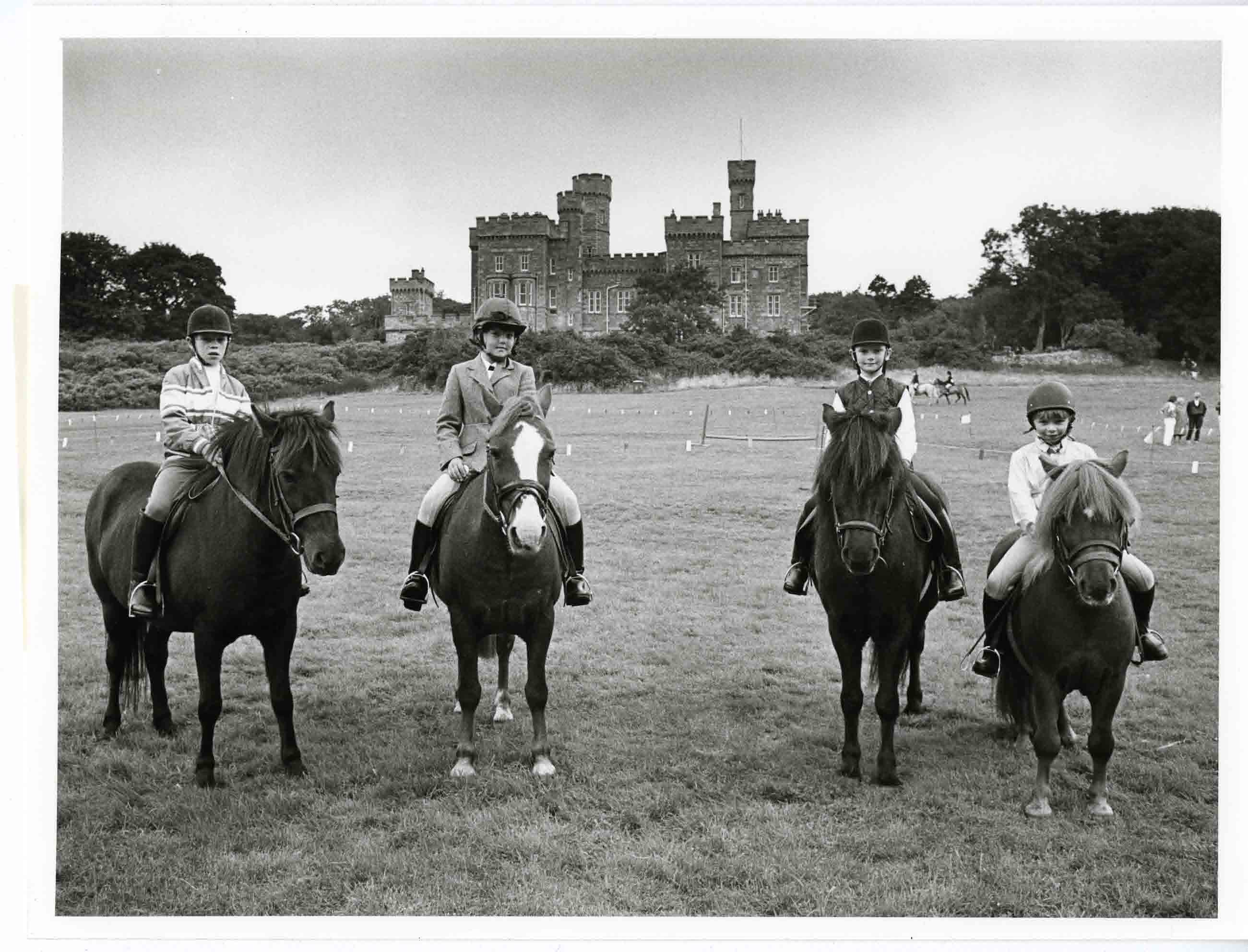 Children on ponies on the castle lawns