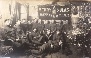 Kenneth MacLeod's Christmas photo postcard from 1916. He is seated in the middle of the front row behind the man lying down.