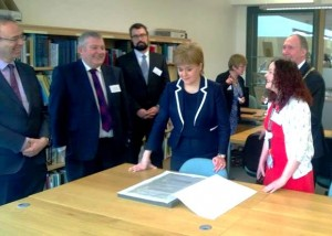 Shona MacLellan, trainee archivist, showing the First Minister the Hudson Bay Contract
