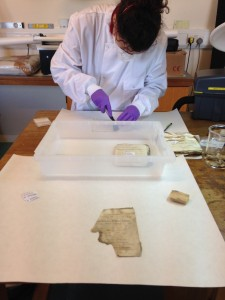 Jane working in the lab with the weaving slips and the smoke sponge