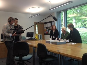 Calum Angus MacKay filming in the archive for Mac TV / BBC Alba